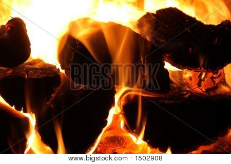 Glowing Wood Logs A Fireplace