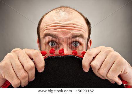 Surprised Man Hiding Behind Sombrero Hat