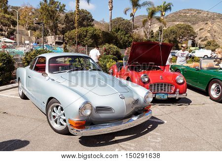 Laguna Beach, CA, USA - October 2, 2016: Silver 1972 VW Karmann Ghia owned by Ike and Ramila Madouras and displayed at the Rotary Club of Laguna Beach 2016 Classic Car Show. Editorial use.