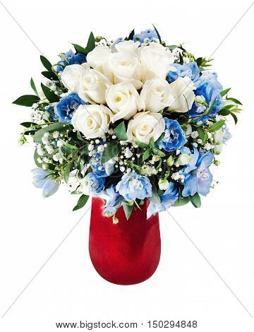 Colorful floral bouquet from white roses and delphinium flowers arrangment centerpiece in red vase isolated on white background.