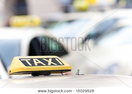 Taxi sign on a car with a shallow depth of field
