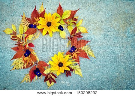 Autumn Wreath Of Rudbeckia And Pansies Flowers, Red And Yellow Grapes And Fern Leaves On A Neutral G