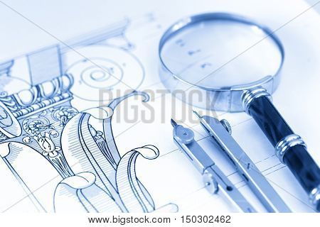 architecture blueprint, magnifying glass & compass