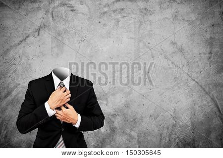 Headless businessman on concrete texture background with copy space