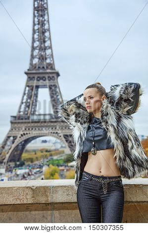 Trendy Woman Against Eiffel Tower In Paris Looking Into Distance