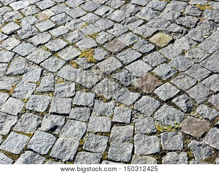 Texture of the granite cobblestoned pavement. Architectural background