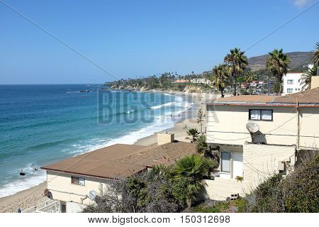 LAGUNA BEACH, CALIFORNIA - OCTOBER 3, 2016: Main Beach. Looking north from Browns Park over homes and businesses.