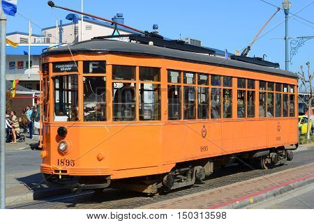 SAN FRANCISCO - MARCH 14: F-line Antique Peter Witt streetcar No.1895 Milan (Italy) in Fisherman's Wharf on March 14th, 2014 in San Francisco, California, USA.
