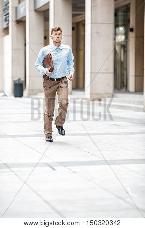 Businessman With  Briefcase Running