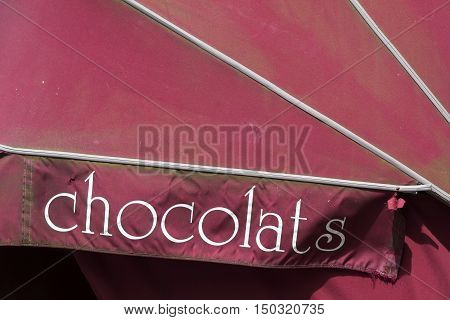 sign for chocolate on red window blind in the belgian town of brugge