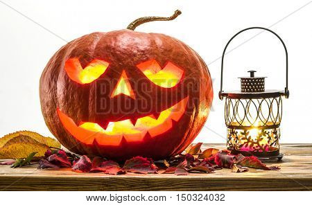 Grinning pumpkin lantern or jack-o'-lantern is one of the symbols of Halloween. Halloween attribute.