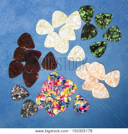 Guitar plectrums isolated on a blue background