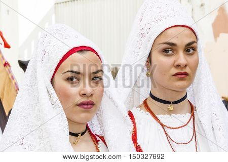 CAGLIARI, ITALY - May 1, 2016: 360 ^ Sant'Efisio Festival - Sardinia - portrait of beautiful girls in traditional Sardinian costume
