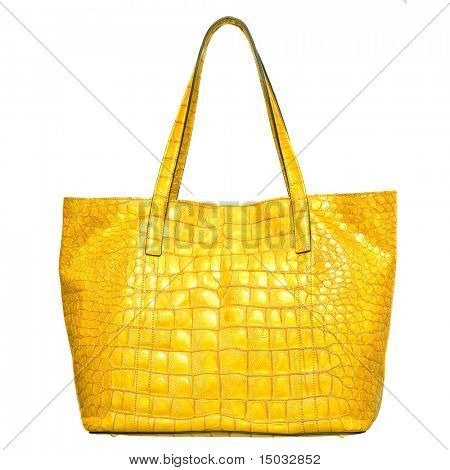 luxury yellow leather female bag isolated on white