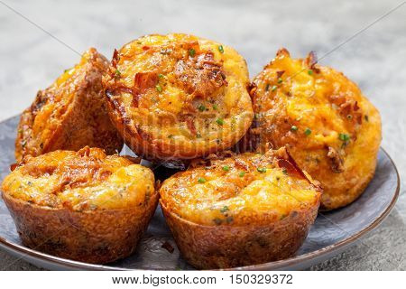 Delicious breakfast egg muffins with sausage, bacon, baked beans and hash brown