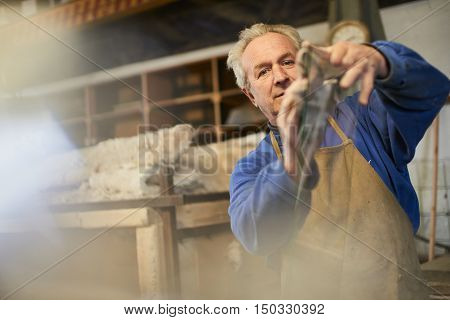 The wizard rubs the glass with a cloth