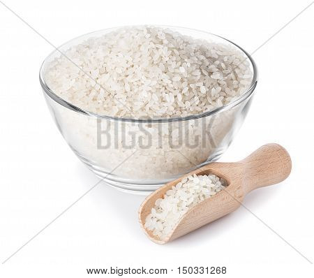 rice in glass bowl with scoop near closeup isolated on white background with clipping path. Rice. Polished rice heap in small glass bowl isolated on white. Rice in glass bowl