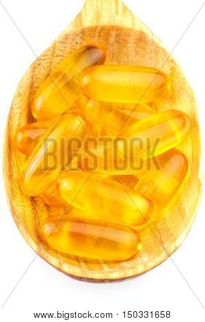 Full spoon of fatty acid omega 3 capsules isolated on white background