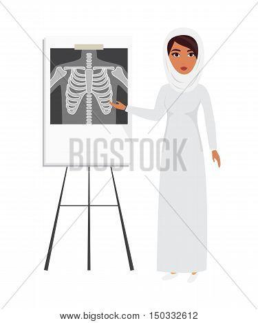 Arab muslim doctor wearing veil hijab with x-ray film