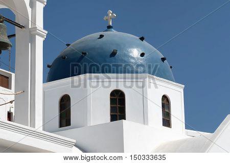 Blue dome of church on Santorini island Greece