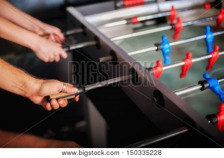 Friends Having Fun Playing Table Foosball