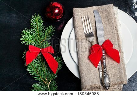 Christmas table setting with christmas decorations. Top view, copyspace.
