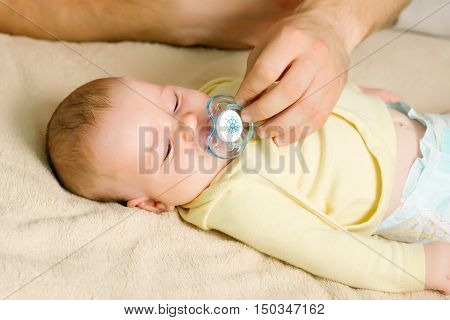 Mother Give Baby`s Pacifier