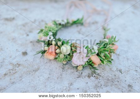 at sunset on the beach with salt crystals wreath of delicate flowers