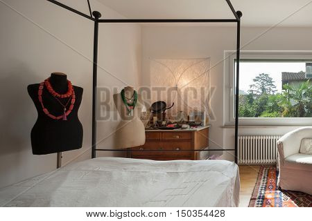 Interior, comfortable bedroom with two dummies