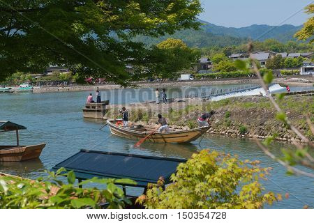 KYOTO, JAPAN - APRIL 30 , 2016: boats in the river at Arashiyama, Kyoto, Japan. Arashiyama  , Scenic Beauty and Historic .  Kyoto, Japan. APRIL 29 2016.