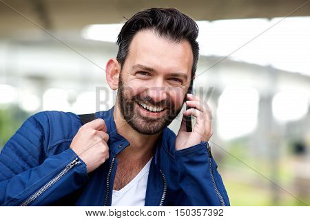 Happy Mature Man Using Mobile Phone And Smiling