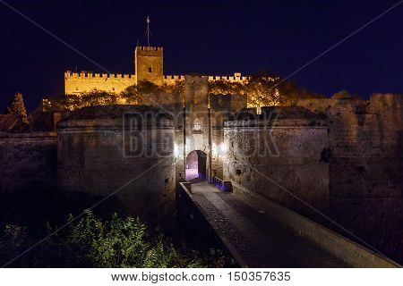 Medieval city walls in Rhodes town night