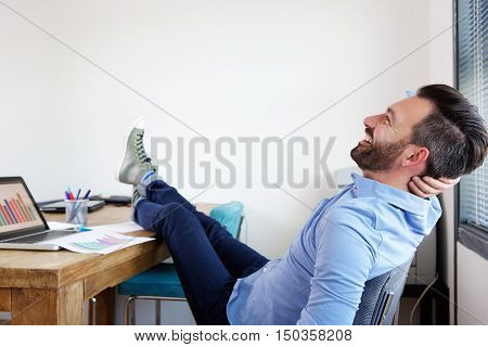 Mature Business Man Relaxing In Office