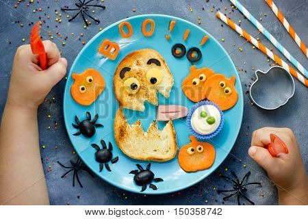 Creative idea for Halloween healthy and funny food for kids top view