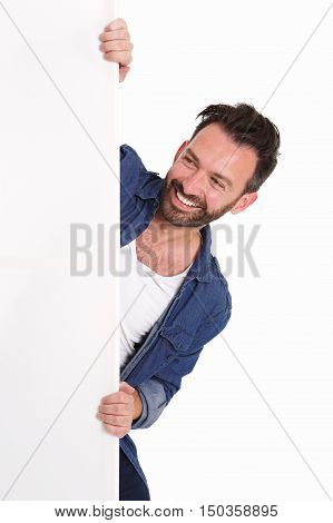 Happy Mature Man Peeking Over Blank Poster Sign