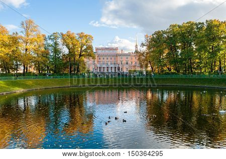 ST PETERSBURG RUSSIA-OCTOBER 3 2016. Mikhailovsky Castle or Engineers Castle in St Petersburg Russia reflecting in Karpin pond water. Architecture landscape of St Petersburg Russia