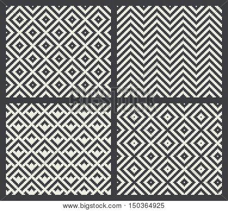 Four abstract pixel mosaics in black and white