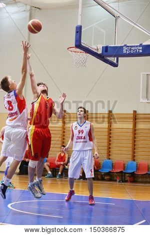 MOSCOW, RUSSIA - DECEMBER 12, 2015: Fight for the ball under the ring during basketball match at the indoor stadium betwen CSKA and Labor Reserves teams.