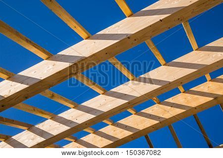 Residential Construction Home Framing Against A Blue Sky