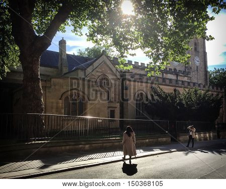 NOTTINGHAM ENGLAND - OCTOBER 3: Male tourist photographing woman St Peter's church - behind. In Nottingham England. On 3rd October 2016.