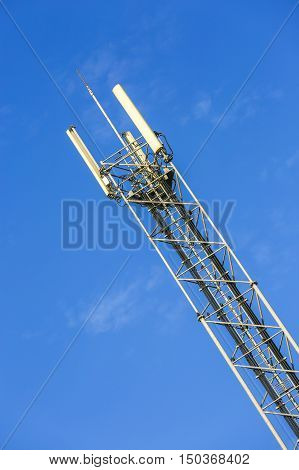 A high telecommunication network antenna and the beautiful clear blue sky