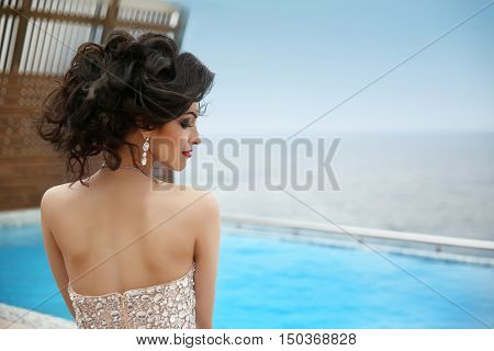 Hairstyle. Beautiful Glamour Gorgeous Woman Model With Diamond Jewelry, Makeup Red Lips. Fashion Gir
