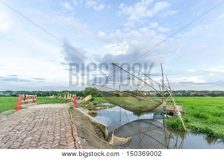 Gopalgonj Bangladesh - September 18 2016: fishnet with fisherman at Gopalgonj Bangladesh
