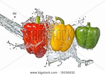 ?red, yellow and green pepper with water splash isolated on white
