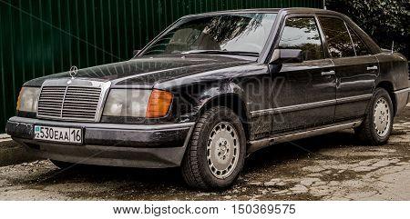 Kazakhstan, Ust-Kamenogorsk, october 2, 2016: Mercedes-Benz W124, old car, old german car in the street, battered, sedan