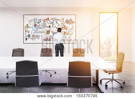 Rear view of businessman working at graph on whiteboard in sunlit board room of large company. Concept of presentation. 3d rendering. Toned image