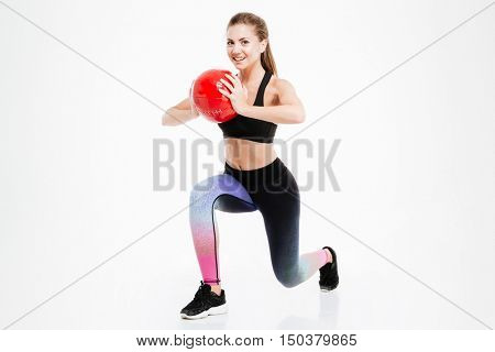 Portrait of a beautiful woman workout with fitness ball isolated on a white background