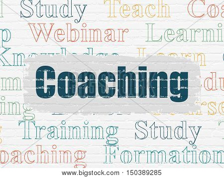 Education concept: Painted blue text Coaching on White Brick wall background with  Tag Cloud