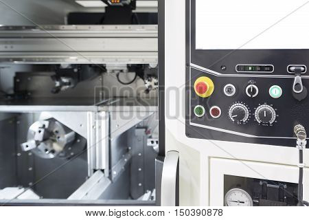 The control panel of CNC turning machine or lath machine.The emergency button and jog selector on the control panel of CNC lath machine