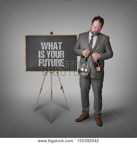 What is your future text on blackboard with businessman and key